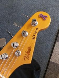 Purple Ribbon Lapel Pin on Guitar